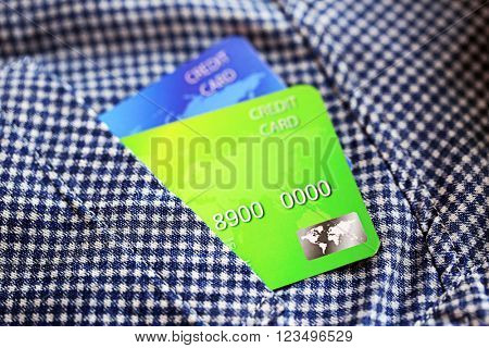Credit cards in shirt pocket, close up
