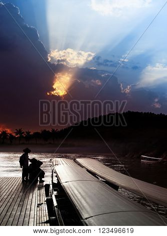 locals on pier and sky over Khwae Yai river