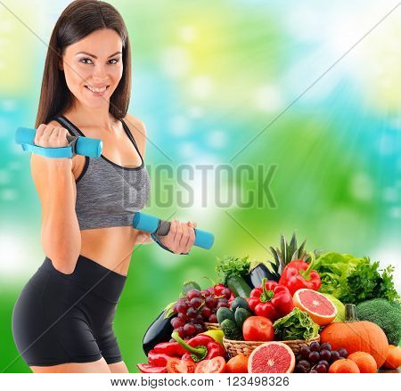 Young Woman With Variety Of Organic Vegetables And Fruits