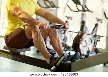 sport male exercise on row machine