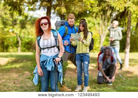Group of youngsters walking in nature as hobby