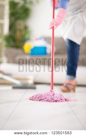 Wiping floor in action during cleaning house