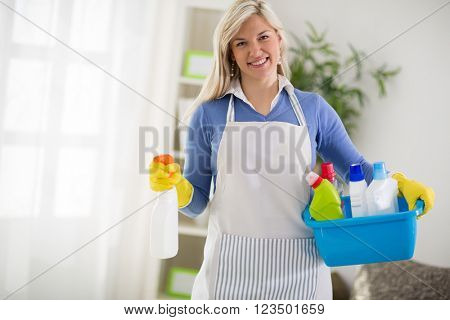 Woman from cleaning service start to clean house