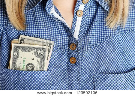Money in cotton shirt pocket, close up
