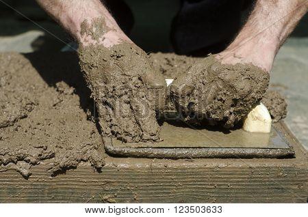 Handicrafts. Preparation Of Mud Bricks In The Plate