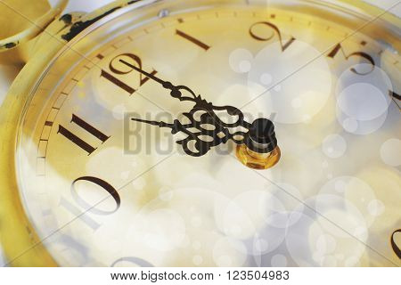 New Year's clock with shining background