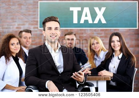 Tax concept. Young business man with his staff at the meeting in a conference room