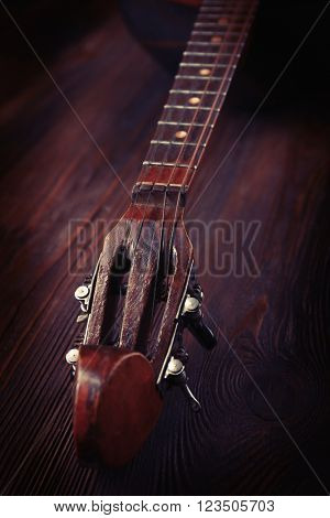 Folk musical instrument domra on wooden background, close up