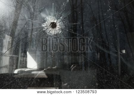 Bullet Hole in old school bus  Window