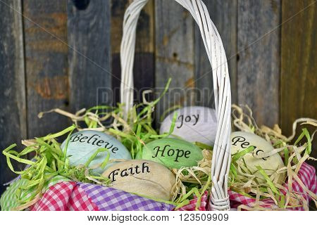 Easter eggs in wicker basket with inspirational messages and gingham fabric.
