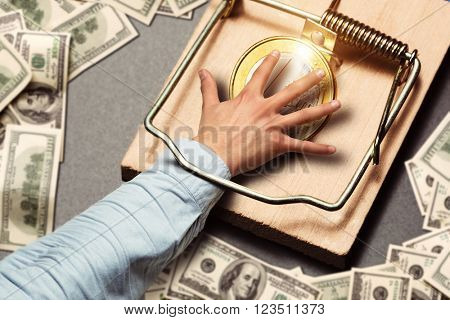 Male hand picking a gold coin