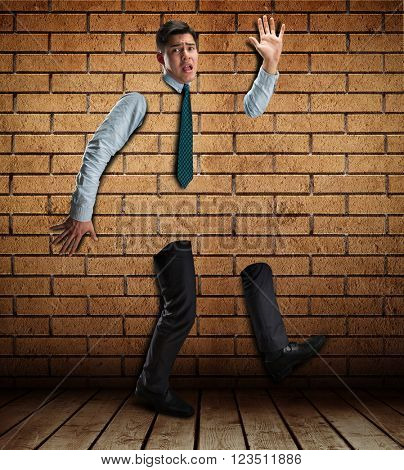 Businessman in the brick wall