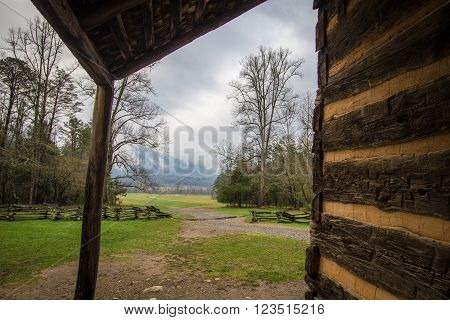 Gatlinburg Tennessee Smoky Mountain Cabin With A View. Front porch of historical log cabin in the Cades Cove valley of the Great Smoky Mountains.