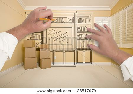Hands Drawing Beautiful Entertainment Unit In Room With Moving Boxes.
