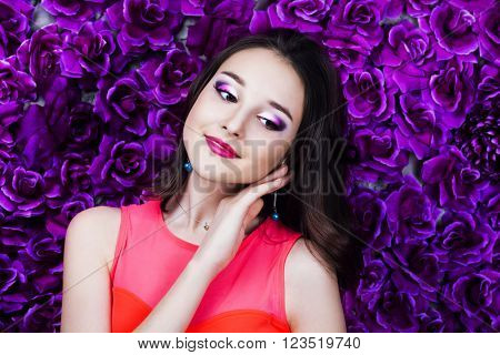 beautiful young brunette teenage girl   with makeup and dark hair in the studio