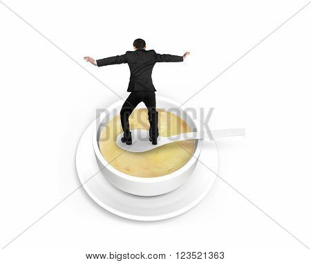 Man balancing on spoon in the soup isolated on white background.