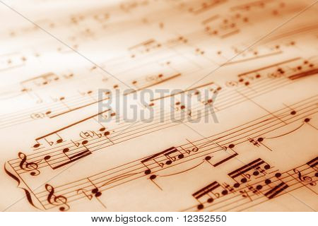 Sheet of musical symbols with warm lighting. Soft focus