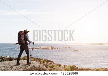 Young man hiker walking in beautiful mountain nature landscape