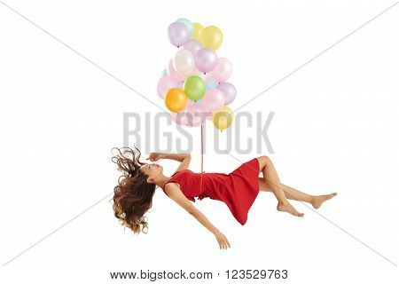 Sleeping Vietnamese woman lifted up by bunch of balloons, isolated on white