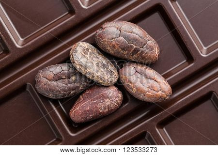 cocoa beans and chocolate bars on white background