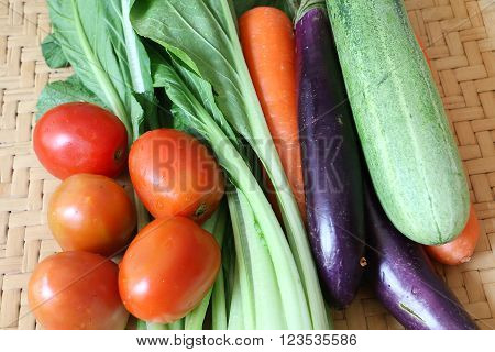 Fresh vegetables on bamboo mat for background or recipe book cover