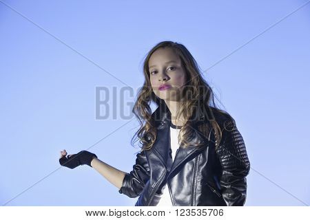 rocker's style caucasian  positive girl on a blue background