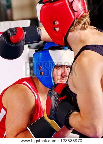 Two sport men boxer wearing helmet and  gloves boxing . Sport concept.