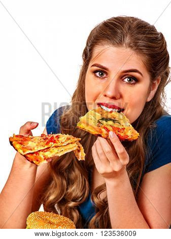 Young beautiful woman eating  few slices of  pizza. Fastfood concept. Isolated.
