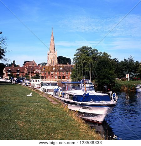 ABINGDON, UK - AUGUST 14, 1991 - View of the River Thames and pleasure boats with St Helens Church to the rear Abingdon Oxfordshire England UK Western Europe, August 14, 1991.