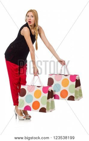 Young caucasian woman with plastic bags isolated on white