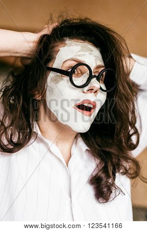 girl with glasses tearing their hair out.. An image of an angry girl tearing her hair