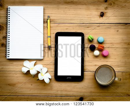 Black Tablet And Empty Book With Hot Coffee And Colorful Sweet On  Wooden Table In Warm Tone
