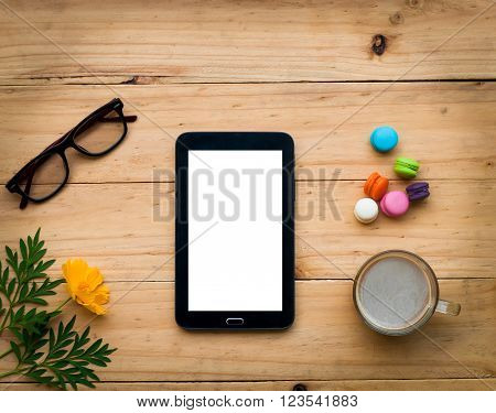 Black Tablet With Hot Coffee And Colorful Sweet On  Wooden Table In Warm Tone.