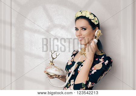Retro Woman With Vintage Phone - Happy young woman talking on a old embellished telephone