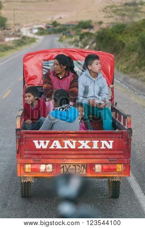 Ollantaytambo, Peru - Circa June 2015: Peruvian Family Riding Truck On The Road To Cusco,  Peru