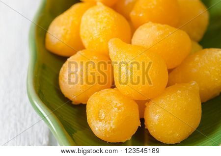 Traditional Thai desserts. Tong Yod (Sweet Egg Yolks Drops) made from egg yolk and flour mixture and cooked in syrup