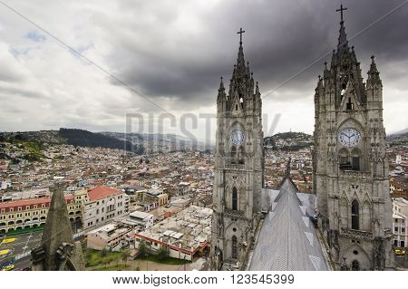 view from top of cathedral on town in Quito, Ecuador with big two towers
