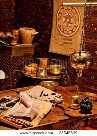 Luxury ayurvedic spa massage interior with India accessories.