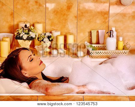 Woman relaxing at water in luxury  home bubble bath.