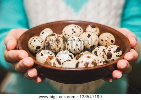 quail eggs are on the brown table in the hands,Easter,Food,Cook,Kitchen,Healthy,Organic