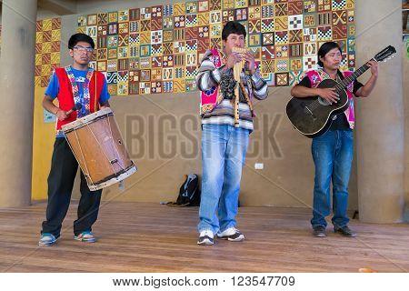 Puno, Peru - Circa June 2015: Musicians Perform In Traditional Peruvian Clothes Near Puno,  Peru