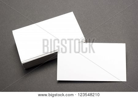 Business card blank over office table. Corporate stationery branding mock-up.