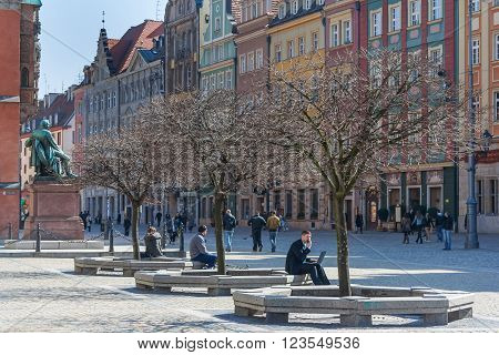 Wroclaw, Poland - Circa March 2012: People Sitting And Relaxing At Central Market Square In Wroclaw,