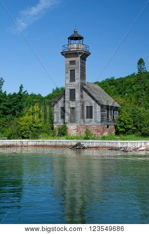 Old lighthouse on the Grand Island from the Superior Lake, Michigan, USA