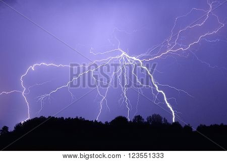 Lightning bolt at night while thunderstorm in Poland
