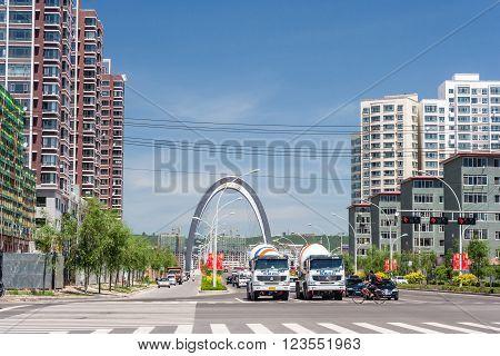 Hunchun, China - Circa July 2012: Streets Of Hunchun And High Rise Residential Buildings, Yanbian, J