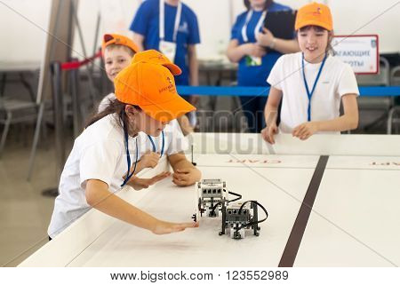 Tyumen, Russia - March 23. 2016: Open championship of professional skill among youth. World skills Russia Tyumen - 2016. Competitions of robots among school students