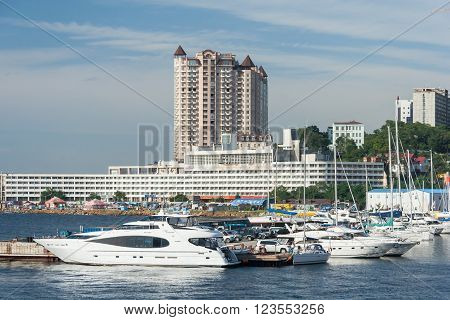 Vladivostok, Russia - Circa August 2014: Sailing Boats And High Rise Residential Buildings In Vladiv