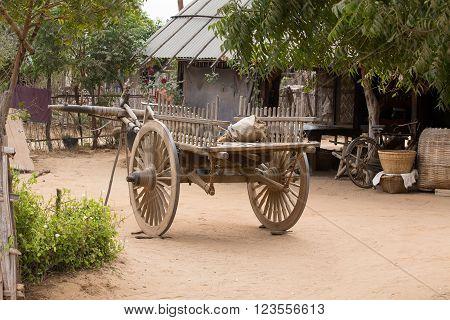 Empty yard with wooden cart. Bagan, Myanmar. Burma