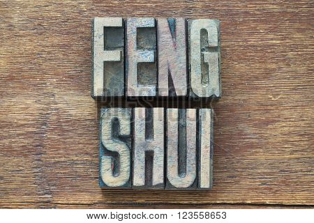 feng shui phrase made from wooden letterpress type on grunge wood